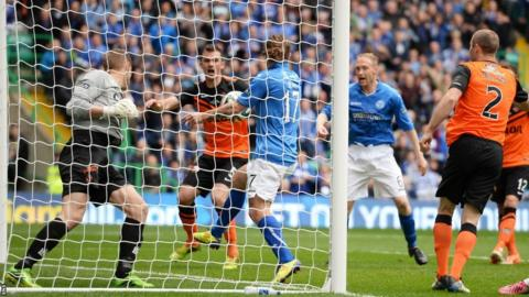 Stevie May puts the ball in the net for St Johnstone but the goal is disallowed for handball