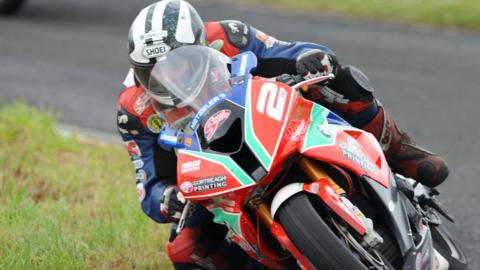 Michael Dunlop moves clear in the Superstock race, which he won after it was stopped because of a crash
