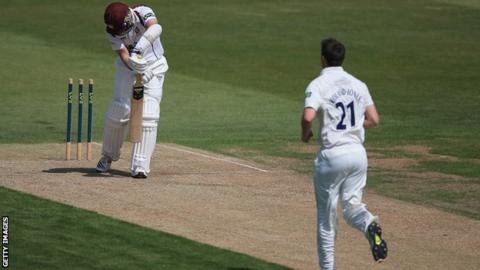 James Middlebrook of Northants looks on, after being bowled by Toby Roland-Jones of Middlesex during their County Championship match