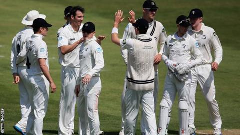 Toby Roland-Jones celebrates a wicket