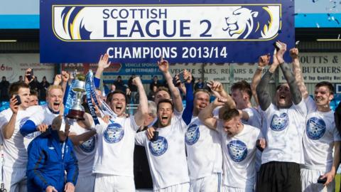Peterhead celebrating with the Scottish League Two trophy