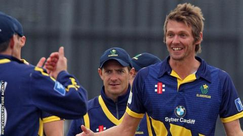 Michael Hogan celebrates taking a wicket for Glamorgan