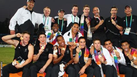 New Zealand celebrate winning gold at the 2010 Commonwealth Games rugby sevens
