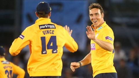 Kyle Abbott celebrates a Sussex wicket with Hampshire team-mate James Vince