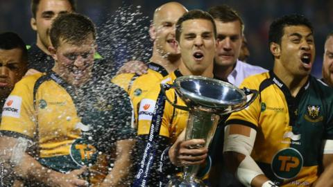 Welsh international George North holds the Amlin Challenge Cup as Northampton Saints beat Bath 30-16 at Cardiff Arms Park.