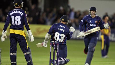 Essex players celebrate after fighting back to beat Glamorgan by four wickets in the final over of their T20 Blast match at Chelmsford.