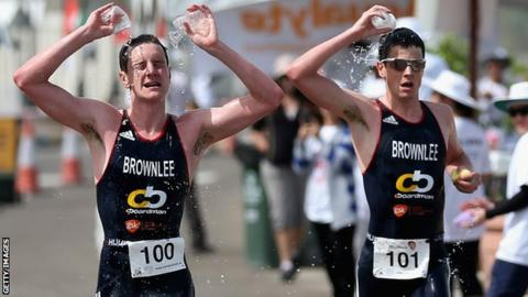 Great Britain's Jonny Brownlee and Alistair Brownlee (L)