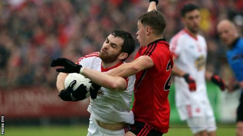 Ronan McNamee is challenged by Jerome Johnston at Pairc Esler