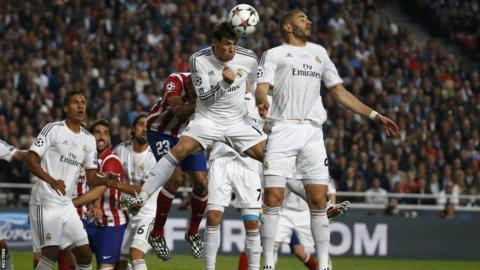 Gareth Bale heads clear for Real Madrid as they are put under early pressure by Atletico Madrid in the Champions League final at the Luz stadium in Lisbon