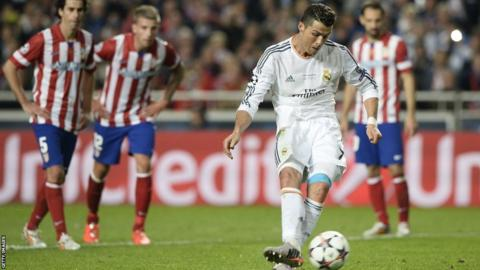 Cristiano Ronaldo scores from the penalty spot, after he was brought down by Gabi, to make it 4-1 to Real Madrid
