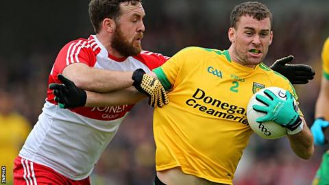 Donegal's Eamon McGee is tackled by Derry's Emmet McGuckin at Celtic Park