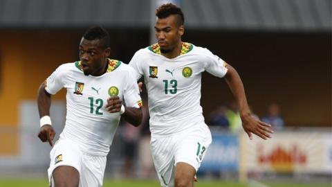 Cameroon forward Eric Maxim Choupo-Moting (right) and defender Henri Bedimo