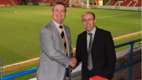 Gloucester City's Stuart Pike (left) with Cheltenham chairman Paul Baker