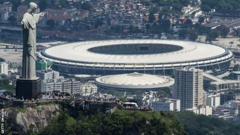 Aerial view of the Christ the Redeemer statue atop Corcovado Hill and the Mario Filho (Maracana) stadium in Rio de Janeiro, Brazil, on December 3, 2013. The Maracana stadium will host the Brazil 2014.