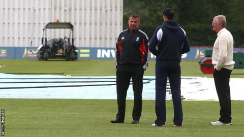 The umpires chat to groundstaff at Merchant Taylor's School