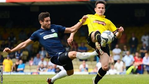 Lee Bell (right) is challenged by Southend's Michael Timlin during the League Two play-off semi-final at Roots Hall