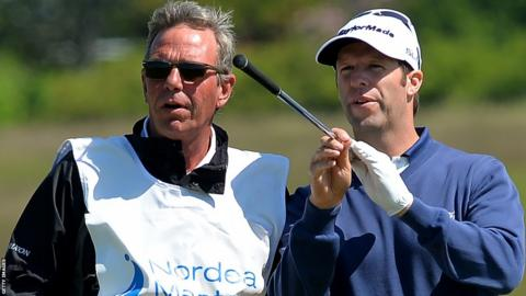 Bradley Dredge waits to play on the 16th fairway with his caddie during a second round 70 at the Nordea Masters at the PGA Sweden National.