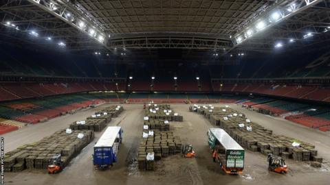 The Millennium Stadium pallets pitch is removed for the final time to make way for a new hybrid playing surface.