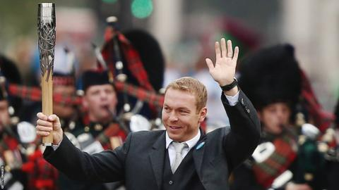 Sir Chris Hoy with the Queen's Baton