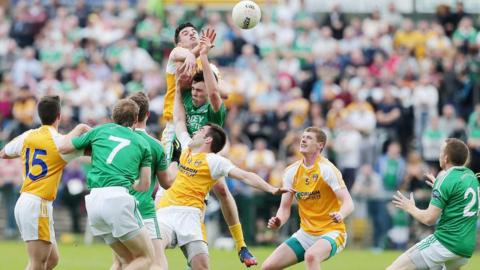 Antrim midfielder Niall McKeever gets above Fermanagh's Ryan Jones in this aerial contest in the Ulster SFC quarter-final at Brewster Park