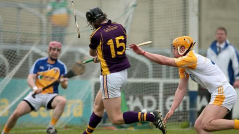 Liam Og McGovern cracks home Wexford's fifth goal despite the efforts of Michael Bradley