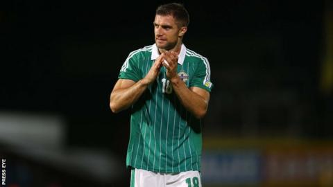 Aaron Hughes hopes to resolve his future after international duty