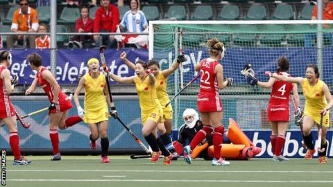 China celebrate scoring against England in the Hockey World Cup in the Netherlands