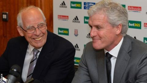 Stoke City chairman Peter Coates and manager Mark Hughes