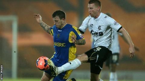 Jamie White (left) in action for Salisbury