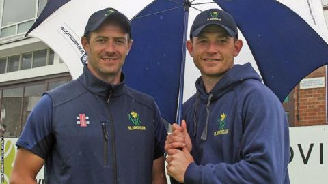 Dean Cosker and Graham Wagg of Glamorgan find shelter from the rain at Chelmsford on the final day of their County Championship match against Essex.
