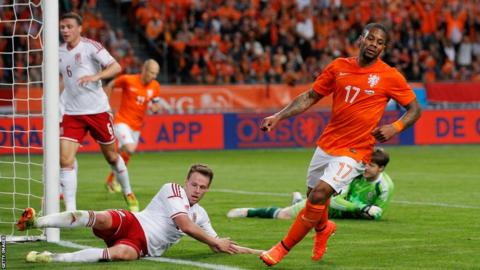 Jeremain Lens celebrates giving the Netherlands a 2-0 lead against Wales in Amsterdam.
