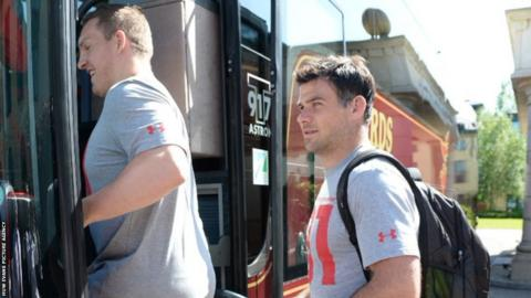 Gethin Jenkins and Mike Phillips board the Wales team coach as the squad leave their team hotel to head to South Africa.