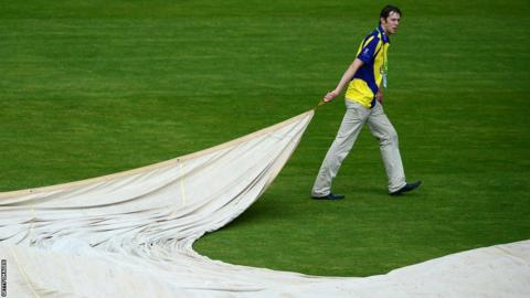 The rain covers are removed following a break in play due to the weather at Bristol for Gloucestershire's T20 Blast match against Glamorgan.