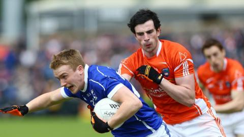 Turloc Mooney wheels away from Aaron Findon as Armagh progress to the Ulster SFC last four