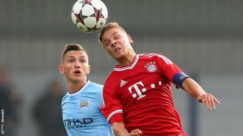 Manchester City's Sinan Bytyqi heads the ball ahead of Bayern Munich's Angelos Oikonomou