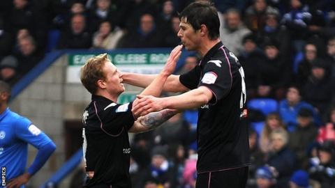 Chris Burke and Nikola Zigic