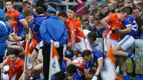 Young members of a band were ushered to safety as players of Armagh and Cavan fought before the match