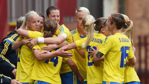 The Swedes celebrate after taking the lead at Fir Park
