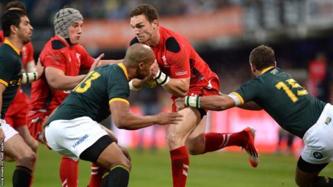 Wales wing George North, fit to start after illness, takes on South Africa's JP Pietersen and Willie le Roux during the first Test in Durban.