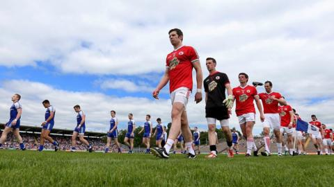 The players of Monaghan and Tyrone pictured during the traditional pre-match parade around the pitch at Clones
