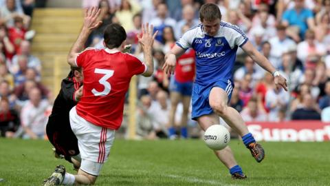 Tyrone keeper Niall Morgan and defender Justin McMahon cannot stop Monaghan corner-forward Dermot Malone from scoring the all-important goal