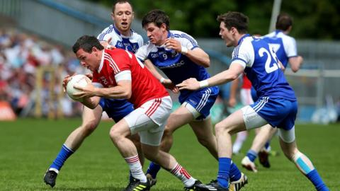 Conor Gormley of Tyrone has his work cut out getting away from Monaghan opponents Vinny Corey, Darren Hughes and Conor McManus