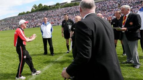Tyrone manager Mickey Harte confronts referee Eddie Kinsella about the amount of time added on at the end of the match