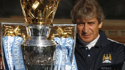 Manchester City boss Manuel Pellegrini with the Premier League trophy