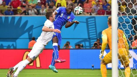 Italy's Mario Balotielli heads the winner past England's Joe Hart