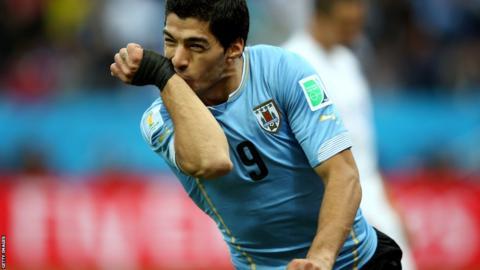 Uruguay striker Luis Suarez celebrates scoring against England