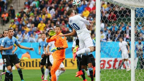 England's Wayne Rooney's heads against the bar against Uruguay