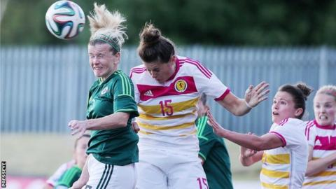 NI's Julie Nelson in aerial action against Scotland's Jennifer Beattie