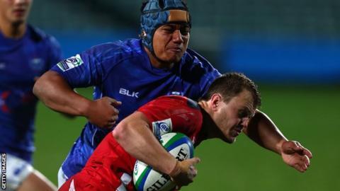 Samoa's Nathaniel Apa and Wales' Steffan Hughes