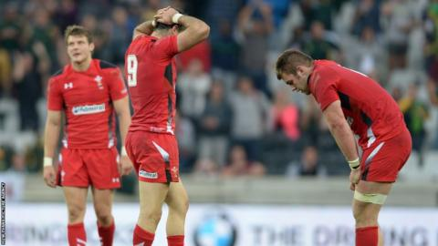 Dan Biggar, Mike Phillips and Dan Lydiate look dejected after Wales are denied a first ever Test win in South Africa.